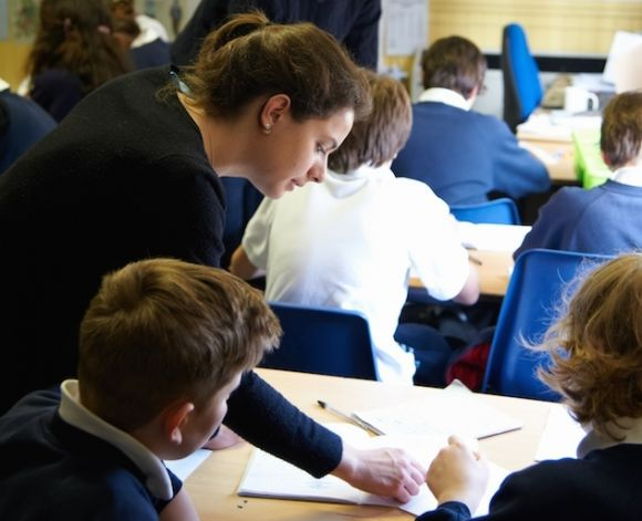 STIMULUS student volunteer helping secondary school pupils